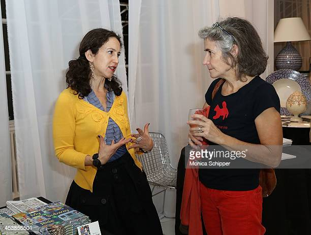 Illustrator Selina Alko talks with a guest at 'love art give a smile' Art Fashion And Design Benefit at Clen Gallery on December 5 2013 in New York...
