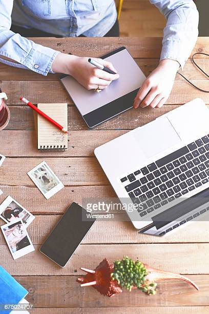 Illustrator working at home using a graphics tablet