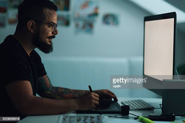 illustrator working late. - illustrator stock photos and pictures