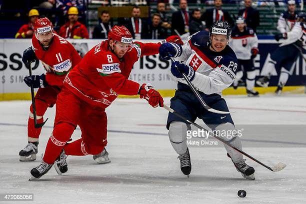 Illya Shinkevich of Belarus and Richard Panik of Slovakia battle for the puck during the IIHF World Championship group B match between Belarus and...