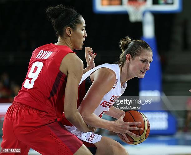 Ilona Burgrova of Czech Republic vies with Miranda Ayim of Canada during 2014 FIBA World Championship For Women an elimination playoff match between...