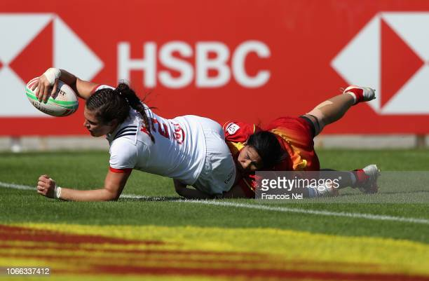 Ilona Delsing Rosa Maher of USA scores a try on day one of the Emirates Dubai Rugby Sevens HSBC World Rugby Sevens Series at The Sevens Stadium on...