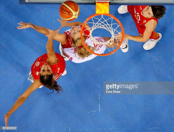 Ilona Korstin of Russia attempts a shot against Tamara Abalde and Elisa Aguilar Lopez of Spain during their quaterfinal women's basketball match on...