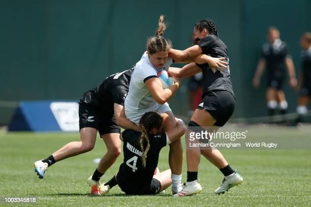 Ilona Maher of the United States is tackled by Niall Williams Sarah Goss and Kelly Brazier of New Zealand during their semi final match on day two of...