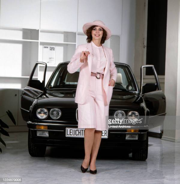 Ilona SchulzBaumgart the wife of singer Klaus Baumgart poses in front of a BMW 3 Series Germany Hamburg 1978/1979