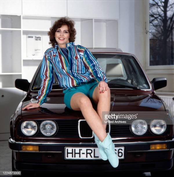 Ilona SchulzBaumgart the wife of singer Klaus Baumgart poses on the hood of a BMW 3 Series Germany Hamburg 1978/1979