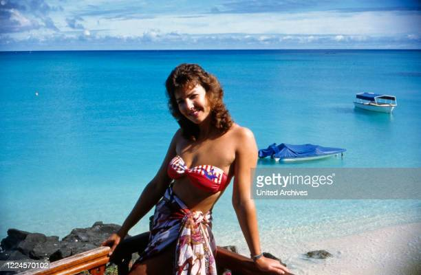 Ilona SchulzBaumgart the wife of the pop singer Klaus Baumgart of the singing duo Klaus Klaus poses in a bikini on the beach probably on holiday in...