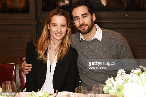 Ilona Smet and Kamran Ahmed attend a private dinner celebrating the APM Monaco flagship store opening at 34 Grosvenor Square on February 11 2016 in...