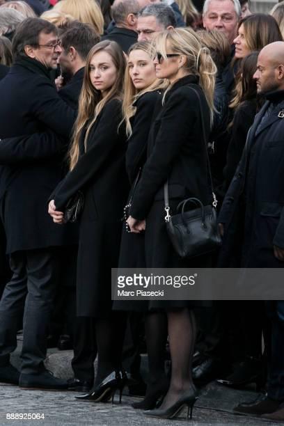 Ilona Smet Emma Smet and Estelle Lefebure are seen during Johnny Hallyday's funerals at Eglise De La Madeleine on December 9 2017 in Paris France...