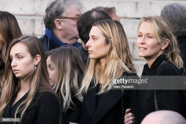 Ilona Smet Emma Smet and their mother Estelle Lefebure are seen during Johnny Hallyday's funerals at Eglise De La Madeleine on December 9 2017 in...