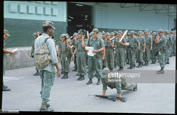 Ilopango Air Force Base El Salvador A United States military adviser orders a Salvadorean Cadet to do pushups for improperly holding his M16 rifle 3/8