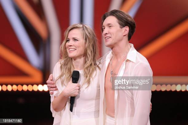 Ilse DeLange and Evgeny Vinokurov talk to the jury after their performance on stage during the 8th show of the 14th season of the television...