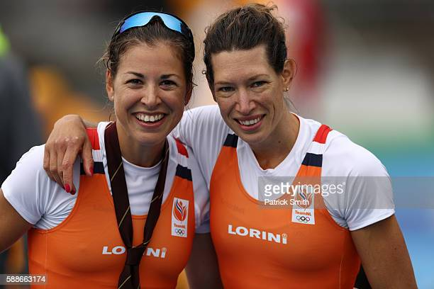 Ilse Paulis and Maaike Head of the Netherlands pose for photographs after winning the gold medal in the Lightweight Women's Double Sculls Final A on...