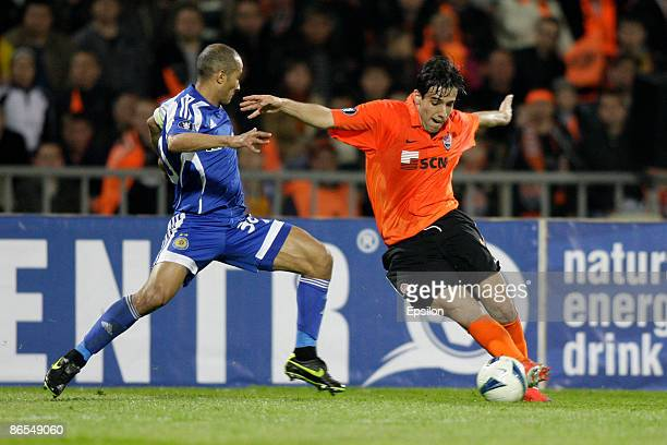 Ilsinho of FC Shakhtar Donetsk battles for the ball with Badr El Kaddouri of FC Dynamo Kiev during the UEFA Cup semifinals second leg match between...