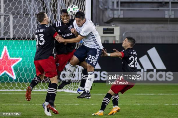 Ilsinho of Philadelphia Union and Donovan Pines of D.C. United battle for the ball during the second half of the MLS game at Audi Field on October...