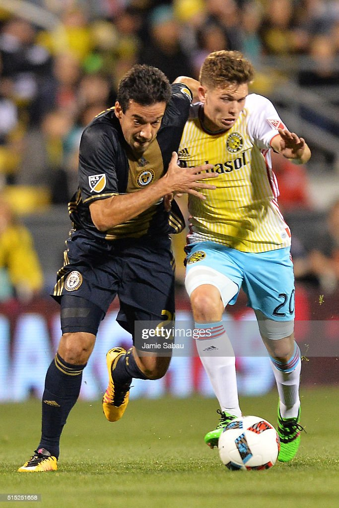 Ilsinho #25 of the Philadelphia Union and Will Trapp #20 of the Columbus Crew SC battle for control of the ball in the first half on March 12, 2016 at MAPFRE Stadium in Columbus, Ohio.