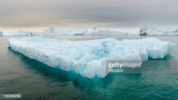 Ilulissat Icefjord also called kangia or Ilulissat Kangerlua at Disko Bay. The icefjord is listed as UNESCO world heritage. America. North America....