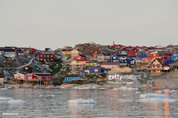 Ilulissat town soaked in the never setting midnight sun Ilulissat town formerly Jakobshavn in evening light Ilulissat is a part of Qaasuitsup...