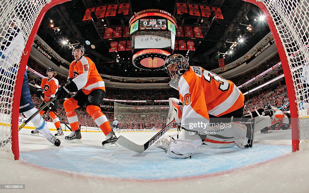 Ilya Bryzgalov #30 and Braydon Coburn #5 of the Philadelphia Flyers watch as play develops behind the net against the Winnipeg Jets on February 23, 2013 at the Wells Fargo Center in Philadelphia, Pennsylvania.