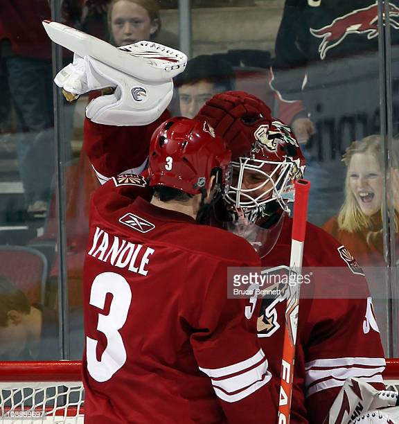 Ilya Bryzgalov is congratulated by Keith Yandle of the Phoenix Coyotes following a 30 shut out against the Colorado Avalanche at the Jobingcom Arena...