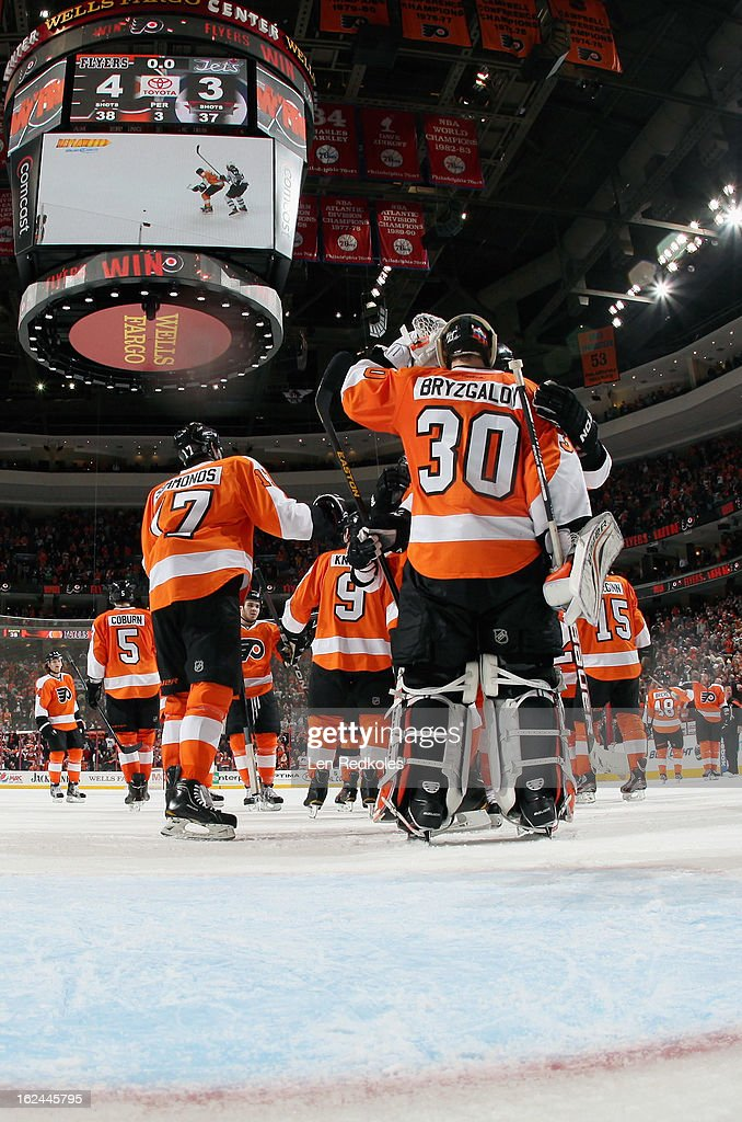 Ilya Bryzgalov #30 of the Philadelphia Flyers celebrates with his team after defeating the Winnipeg Jets 5-3 on February 23, 2013 at the Wells Fargo Center in Philadelphia, Pennsylvania.