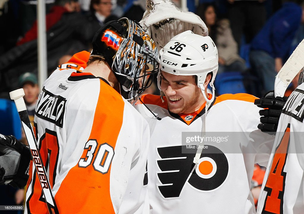 Ilya Bryzgalov #30 of the Philadelphia Flyers is congratulated by teammate Zac Rinaldo #36 on his 400th game and win against the New York Islanders at Nassau Veterans Memorial Coliseum on February 18, 2013 in Uniondale, New York. The Islanders were shut out by the Flyers 7-0.