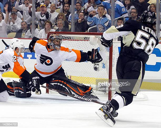 Ilya Bryzgalov of the Philadelphia Flyers makes a glove save on Kris Letang of the Pittsburgh Penguins in Game Two of the Eastern Conference...