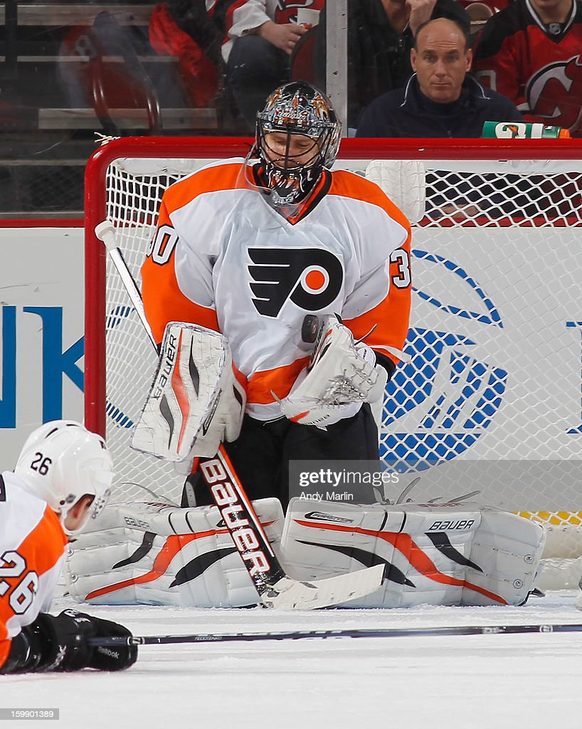 Ilya Bryzgalov #30 of the Philadelphia Flyers makes a save against the New Jersey Devils during the Devils' home opener at the Prudential Center on January 22, 2013 in Newark, New Jersey.