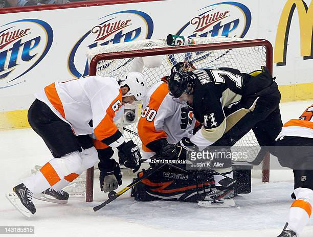 Ilya Bryzgalov of the Philadelphia Flyers makes a save on Evgeni Malkin of the Pittsburgh Penguins in Game Five of the Eastern Conference...