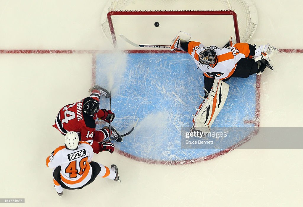 Ilya Bryzgalov #30 of the Philadelphia Flyers makes the save on h14 at the Prudential Center on February 15, 2013 in Newark, New Jersey. The Devils defeated the Flyers 5-3.