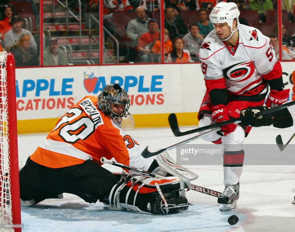 Ilya Bryzgalov #30 of the Philadelphia Flyers stops a shot by Chad LaRose #59 of the Carolina Hurricanes on February 2, 2013 at the Wells Fargo Center in Philadelphia, Pennsylvania.The Philadelphia Flyers defeated the Carolina Hurricanes 5-3.
