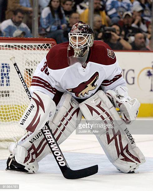 Ilya Bryzgalov of the Phoenix Coyotes watches play in the corner against the Pittsburgh Penguins in the third period at Mellon Arena on October 07...