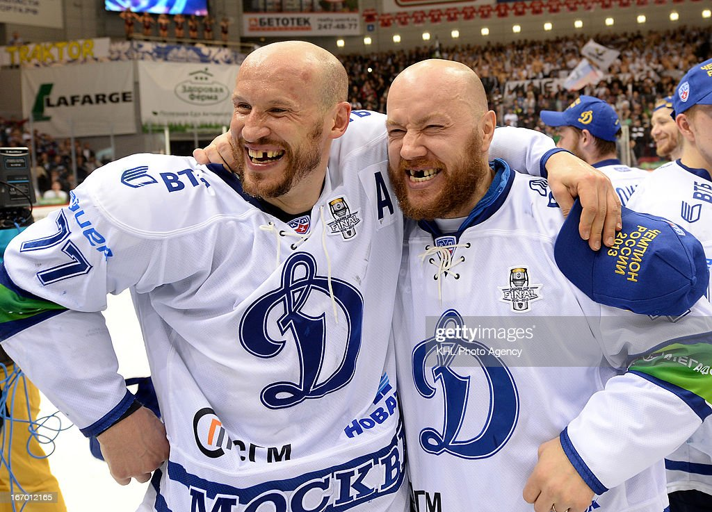 Ilya Gorokhov and Alexander Boikov of Dinamo Moscow celebrate after defeating Traktor Chelyabinsk at the final play-off game during the KHL Championship 2012/2013 on April 18, 2013 at the Arena Traktor in Chelyabinsk, Russia.