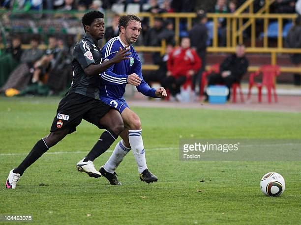 Ilya Gultyayev of FC Tom, Tomsk battles for the ball with Sekou Oliseh of PFC CSKA, Moscow during the Russian Football League Championship match...