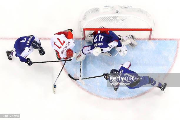 Ilya Kovalchuk of Olympic Athlete from Russia attempts a shot against Ivan Baranka Marek Daloga and Branislav Konrad of Slovakia in the third period...