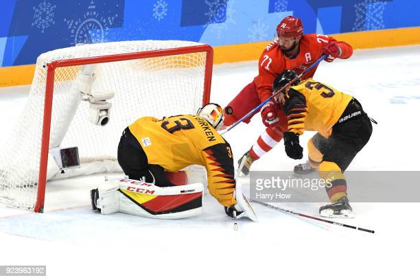 Ilya Kovalchuk of Olympic Athlete from Russia attempts a shot against Danny Aus Den Birken of Germany in the third period during the Men's Gold Medal...