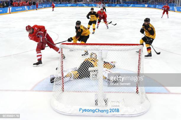 Ilya Kovalchuk of Olympic Athlete from Russia attempts a shot in overtime against Danny Aus Den Birken of Germany during the Men's Gold Medal Game on...