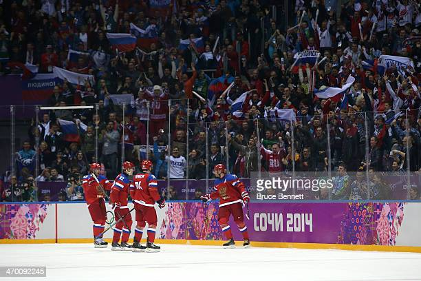Ilya Kovalchuk of Russia celebrates after with his teammates after scoring a goal in the second period against Lars Haugen of Norway during the Men's...