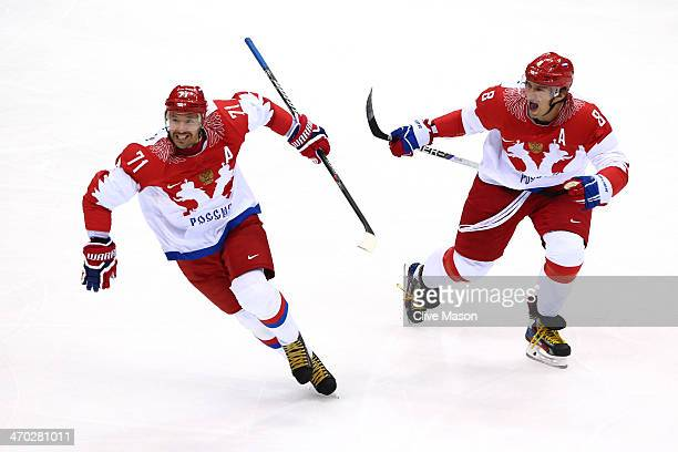 Ilya Kovalchuk of Russia celebrates with teammate Alexander Ovechkin after scoring a firstperiod goal against Finland during the Men's Ice Hockey...