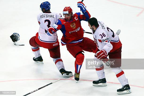 Ilya Kovalchuk of Russia is challenged by Michal Rozsival and Petr Caslava of Czech Republic during the IIHF World Championship gold medal match...