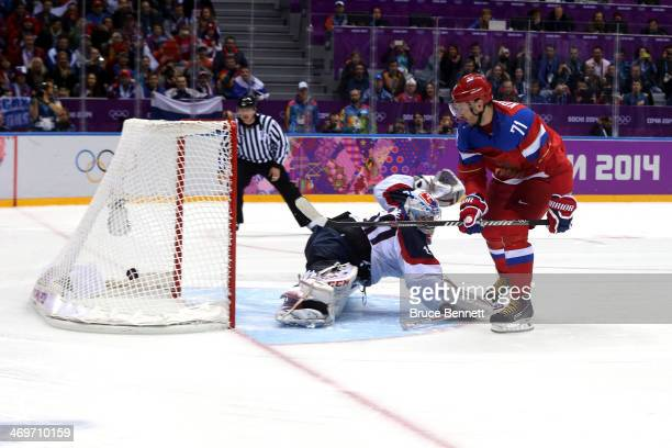 Ilya Kovalchuk of Russia scores a winning goal in a shoot against Jan Laco of Slovakia during the Men's Ice Hockey Preliminary Round Group A game on...