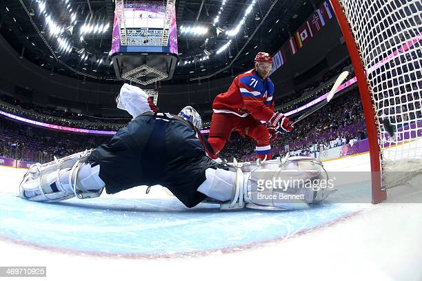 Ilya Kovalchuk of Russia scores the winning goal in a shoot against Jan Laco of Slovakia during the Men's Ice Hockey Preliminary Round Group A game...