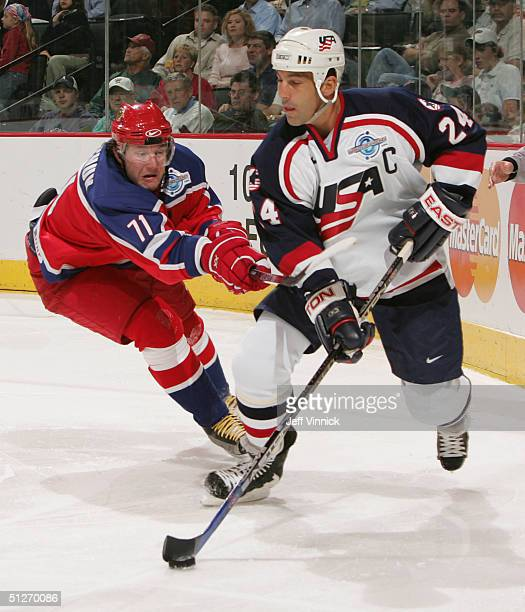 Ilya Kovalchuk of Team Russia tries to check Chris Chelios of Team USA during the third period of their quarterfinal game in the World Cup of Hockey...