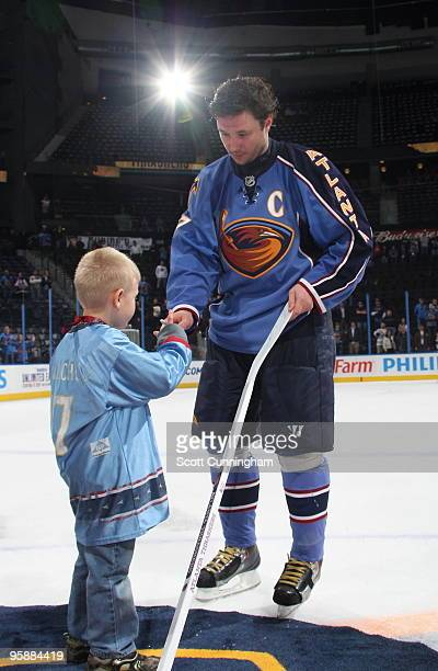 Ilya Kovalchuk of the Atlanta Thrashers gives away an autographed stick to a lucky fan after the game against the Toronto Maple Leafs at Philips...