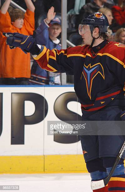 Ilya Kovalchuk of the Atlanta Thrashers points to Sidney Crosby of the Pittsburgh Penguins in the penalty box after scoring a power play goal on...