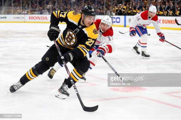 Ilya Kovalchuk of the Montreal Canadiens defends John Moore of the Boston Bruins during the third period at TD Garden on February 12, 2020 in Boston,...