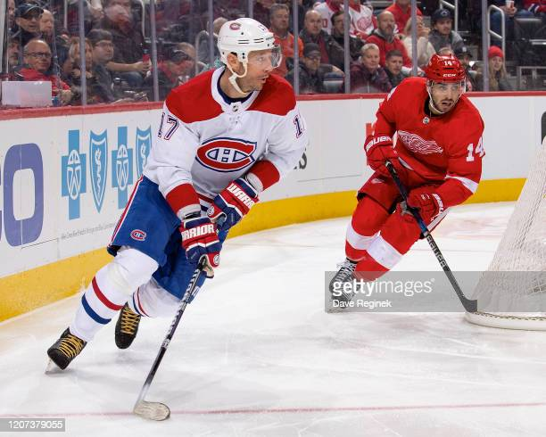 Ilya Kovalchuk of the Montreal Canadiens skates around the net with the puck next to Robby Fabbri of the Detroit Red Wings during an NHL game at...