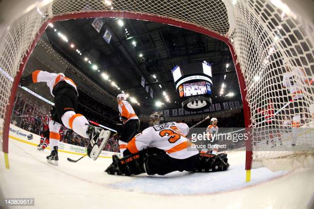 Ilya Kovalchuk of the New Jersey Devils celebrates after scoring a goal in the first period against Ilya Bryzgalov of the Philadelphia Flyers in Game...