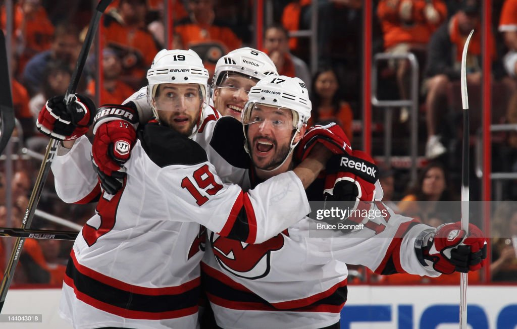 Ilya Kovalchuk #17 of the New Jersey Devils celebrates his powerplay goal at 5:00 of the third period against the Philadelphia Flyers in Game Five of the Eastern Conference Semifinals during the 2012 NHL Stanley Cup Playoffs at Wells Fargo Center on May 8, 2012 in Philadelphia, Pennsylvania. Joining him are Travis Zajac #19 (L) and Adam Larsson #5 (C).