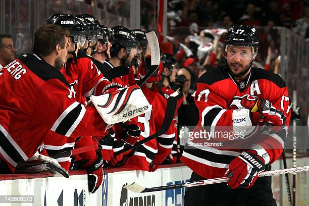 Ilya Kovalchuk of the New Jersey Devils celebrates with his teammates on the bench after a goal in first period against Ilya Bryzgalov of the...